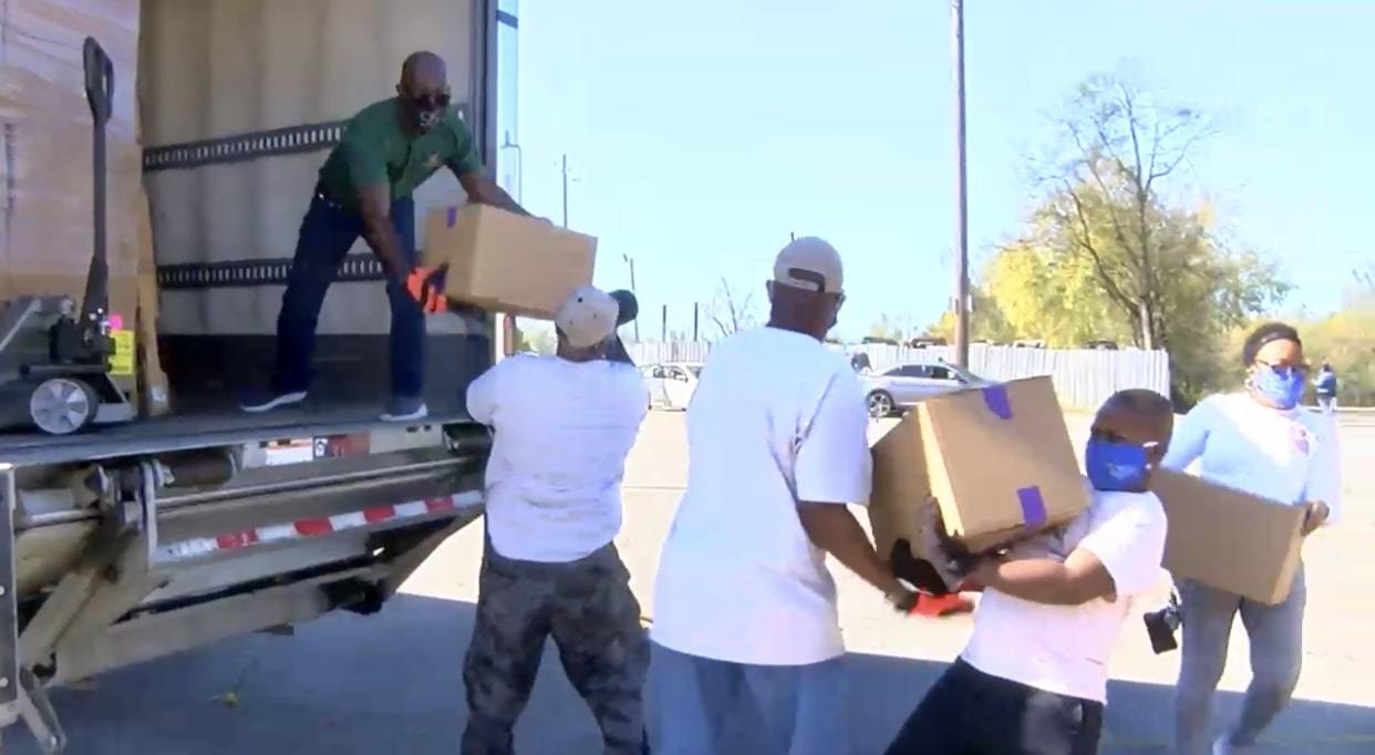 Unloading food boxes at Farmers to Families Ensley event
