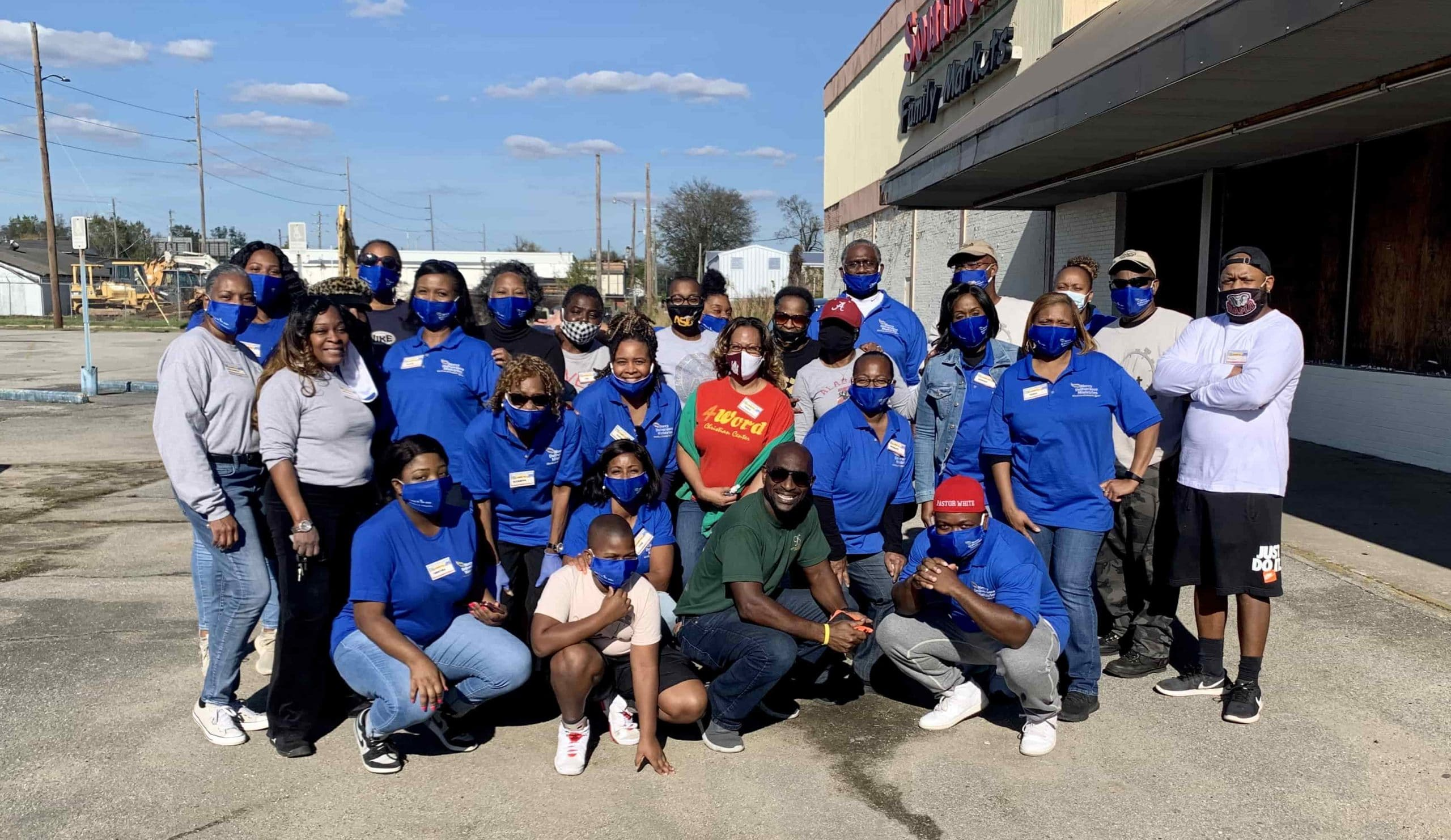 Group Of Volunteers At Farmers To Families Ensley Event